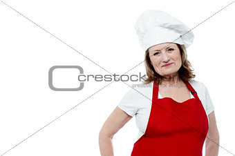 Aged female chef posing in style