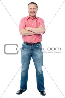 Casual aged man standing on white background