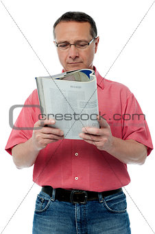 Casual senior man reading a book