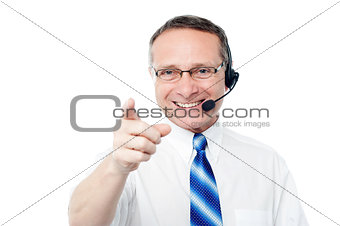 Mature business execuitve with headset