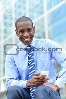 Business executive using his smart phone