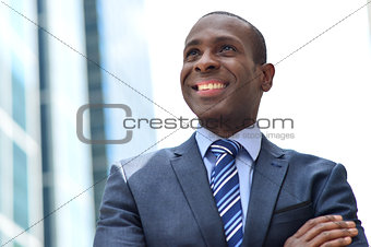 Smiling black businessman at outdoors