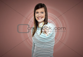 Attractive woman touching virtual screen