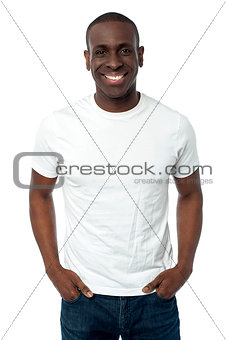 African man smiling isolated over a white
