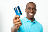 Smiling guy holding credit card