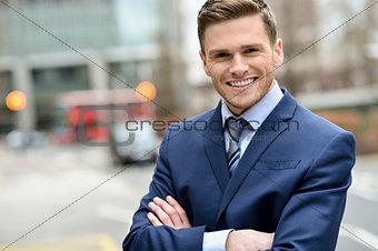 Smiling businessman posing for the camera