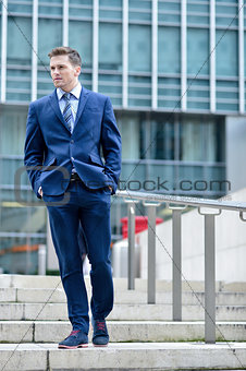 Corporate guy walking down the stairs