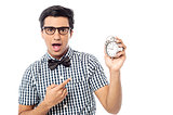 Excited man holding an antique clock