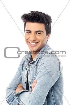 Casual smiling man with arms crossed
