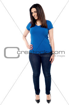 Casual young woman standing isolated on white