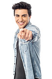Happy young man pointing at you