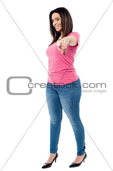 Attractive casual women pointing