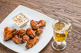 Baked chicken wings with spicy sauce