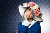 spring woman posing with fashion hat