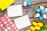 Easter background with blank photo frames, blue and white eggs,