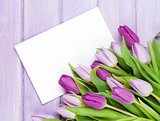 Purple tulip bouquet and blank greeting card
