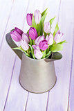 Watering can with purple tulips