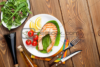 Grilled salmon, salad and condiments