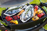 Fresh dorado fish and bell pepper grill cooking