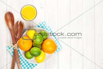 Citrus fruits. Oranges, limes and lemons and orange juice