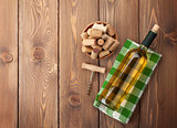 White wine bottle, corks and corkscrew