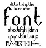 Handwritten black distorted gothic lower case alphabet with symbols