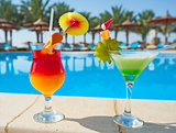 Cocktail drinks by a swimming pool
