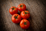 Tomatoes on wooden table