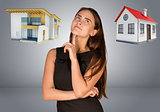 Business woman thinking over house and cottage