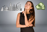 Beautiful business woman thinking over money and buildings
