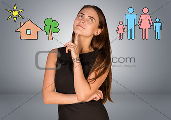 Beautiful business woman thinking over family and house with tree