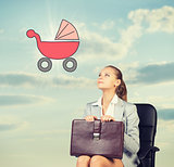 Business woman in skirt, blouse and jacket, sitting on chair imagines buggy. Against background of sky, clouds