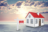 White house with red roof and chimney. Near there is signboard for rent. Background sun shines brightly