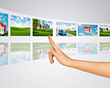 Subject homes for sale. Finger presses one of virtual screens