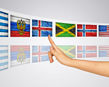 Theme flags. Finger presses one of virtual screens