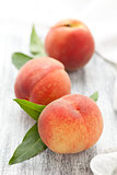 Peaches on rustic table.