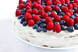 Creamy sweet cake with blueberries and raspberries