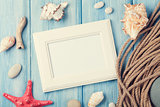 Sea vacation with blank photo frame, star fish and marine rope