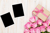 Pink roses and valentines day gift box and two blank photo frame