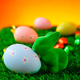 easter rabbit and decorated eggs on the grass