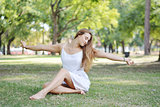 Relaxed woman on the grass Outdoors.
