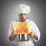 Chef blowing burnt food