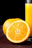 full glass of orange juice near half orange with space for text