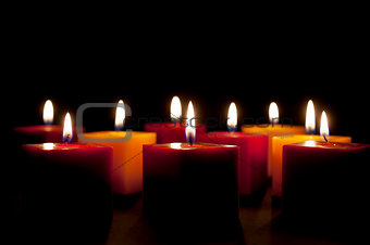candles lighting in the darkness