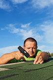 Man fastening bitumen roof shingles