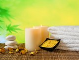Spa massage border background with towel stacked, candles and sea salt