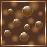 Brown chocolate balls on brown background.