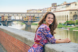 Portrait of young woman on embankment near ponte vecchio in flor