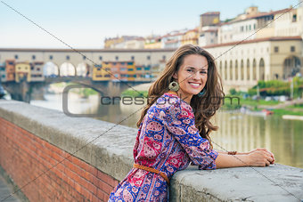 Portrait of young woman on embankment near ponte vecchio in flor