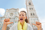 Happy young woman pointing on herself in front of duomo in flore